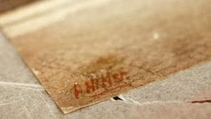The signature of former German dictator Adolf Hitler is seen on a painting of the old registry office in Munich, at Weidler auction house in Nuremberg November 18, 2014.(REUTERS//Kai Pfaffenbach/File Photo)