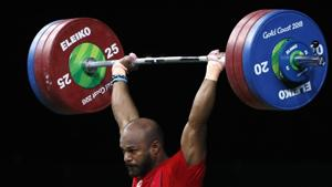 Sathish Kumar Sivalingam of India lifts his way to gold in the 77kg weightlifting final at the 2018 Commonwealth Games (CWG 2018) in Gold Coast.(REUTERS)