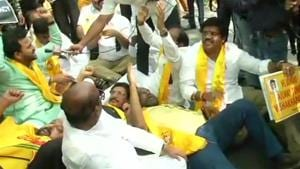 TDP MPs protest outside Prime Minister's residence at Lok Kalyan Marg over demand of special category status for Andhra Pradesh on Sunday.(ANI Photo)