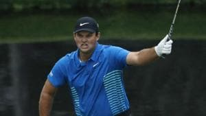 Patrick Reed of the US celebrates chipping in for an eagle on the 15th hole during third round play of the 2018 Augusta Masters golf tournament at the Augusta National Golf Club in Georgia on Saturday.(REUTERS)