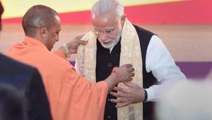 Prime Minister Narendra Modi and Uttar Pradesh chief minister Yogi Adityanath during the inauguration of UP Investors Summit 2018 at Indira Gandhi Prathishthaan in Lucknow on February 21, 2018.(PTI File Photo)