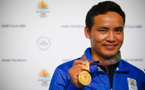 India's Jitu Rai celebrates winning the gold medal on the podium following the men's 10m air pistol shooting final during the 2018 Gold Coast Commonwealth Games at the Belmont Shooting Complex in Brisbane on April 9, 2018.(AFP)
