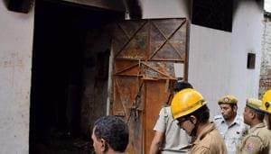 Delhi Fire Service personnel inspect the building of Raja Park factory where a major fire broke out around 6.35 am, in Sultanpuri, New Delhi on Monday.(PTI Photo)