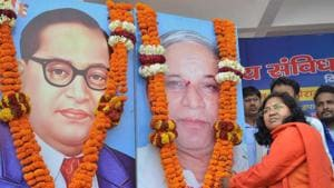 BJP MP Savitri Bai Phule offers tributes to Dalit icons Bhimrao Ambedkar and Kansiram during a rally. The BJP MP from Bahraich alleged the Centre had remained a mute spectator to atrocities against Dalits during the 'Bharat Bandh' and the Uttar Pradesh dovernment had failed to check the continuing vandalisation of Dr Bhim Rao Ambedkar's statues.(PTI File Photo)