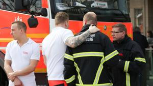 Emergency personnel of the fire brigades stand in front of an entrance to the blocked Jungfernstieg subway station in Hamburg, northern Germany, on April 12, 2018, after a stabbing.(AFP)
