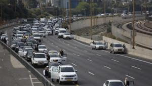 People stand still as a two-minutes silence in memory of victims of the Holocaust in Tel Aviv, Israel.(AP Photo)