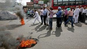 Activists of National Panther party burn tyres and shout slogans during a protest in support of various demands, including deportation of Rohingyas and Bangladeshi nationals from Jammu, and a CBI probe into the rape and murder of an eight-year-old girl in Kathua on January, Jammu April 11, 2018.(REUTERS File Photo)