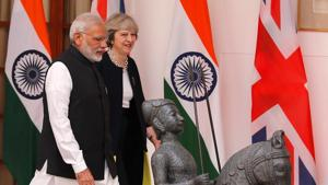 Prime Minister Narendra Modi and his British counterpart Theresa May ahead of their meeting in New Delhi in November 2016.(REUTERS FILE)