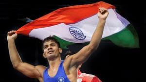 Rahul Aware holds tricolour after winning the match against Canada's Steven Takahashi in the men's freestyle 57kg wrestling final at the Commonwealth Games 2018 in Gold Coast on Thursday.(PTI)