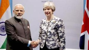 Prime Minister Narendra Modi meets Britain's Prime Minister Theresa May on the sidelines of the 12th G-20 Summit, in Hamburg, Germany.(PTI File Photo)