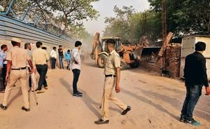 MCG officials said although there was brief resistance from residents at one of the four residential buildings within the restricted area, the matter was quickly resolved without violence due to the heavy police deployment.(Parveen Kumar/HT PHOTO)