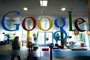 A Google Inc member of staff walks through the company headquarters in London, UK.(Simon Dawson/Bloomberg)