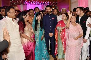 Rashtriya Janata Dal chief Lalu Prasad Yadav's elder son Tej Pratap Yadav with fiancee Aishwarya Rai, granddaughter of former Bihar chief minister Daroga Prasad Rai, during their engagement function in Patna on Wednesday.(PTI)