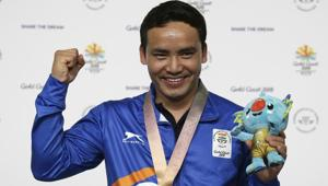Jitu Rai of India poses with his gold medal in the men's 10m Air Pistol final at the 2018 Commonwealth Games in Gold Coast.(AP)