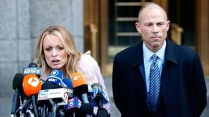 Adult film actress Stephanie Clifford, also known as Stormy Daniels, speaks to media along with lawyer Michael Avenatti (R) outside federal court in the Manhattan borough of New York City, US, April 16, 2018.(REUTERS)