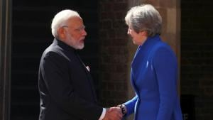 Prime Minister Narendra Modi greets Britain's Prime Minister Theresa May ahead of a working session at the Commonwealth Heads of Government Meeting in London on April 19, 2018.(Reuters)
