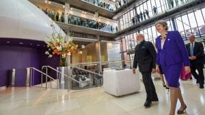 Prime Minister Narendra Modi with British Prime Minister Theresa May visits the Francis Crick Institute in London on Wednesday.(PTI Photo)