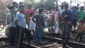 Protesters hold a rail-roko to protest the incidents of rape and murder in Kathua and Unnao.(HT Photo)