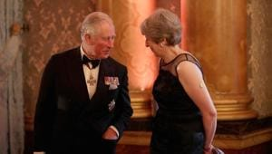 Britain's Prince Charles speaks to Prime Minister Theresa May before taking part in a receiving line at the Queen's Dinner for the Commonwealth Heads of Government Meeting (CHOGM) at Buckingham Palace in London, on April 19, 2018.(Reuters)
