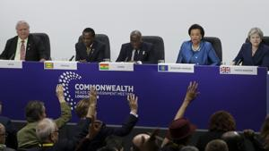 Journalists put their hands up to ask questions during the closing press conference for the Commonwealth Heads of Government Meeting (CHOGM) at Marlborough House in London on Friday.(AP)