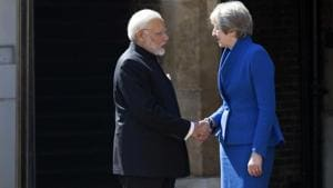 British PM Theresa May greets Prime Minister Narendra Modi at the official welcome ceremony for the Commonwealth Heads of Government Meeting in London.(AP)