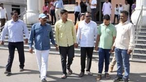 Congress corporator Vishal Kotkar (in yellow) arrested in Kedgaon double murder case in Ahmednagar on Tuesday.(HT Photo)