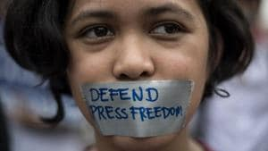 A college student participates in a protest to defend press freedom in Manila. A Reporters Without Borders survey says Norway topped the list of having the world's freest press for the second year in a row.(AFP Photo)