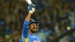 Rajasthan Royals batsman K Gowtham celebrates after hitting the winning runs during the 2018 Indian Premier League (IPL 2018) match against Mumbai Indians in Jaipur on April 22.(AFP)