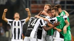 Juventus players celebrate after their win over Inter Milan in Serie A at San Siro, Milan, on Saturday.(Reuters)