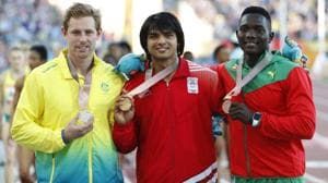 There was rare track-and-field success for India this month at the Carrara Stadium at Gold Coast when the 20-year-old Neeraj Chopra (C) won the javelin at the Commonwealth Games 2018.(REUTERS)