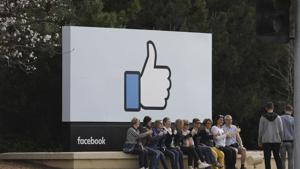 Tourists at Facebook's headquarters, Menlo Park, California. Mark Zuckerberg also built Facebook by imitating MySpace and Friendster, and he continues to copy products(NYT)