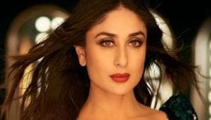 Kareena Kapoor Khan's shimmering skin and glossy wavy hair positively gleam with her totally embellished rama green gown. See pictures below. (YouTube screenshot)