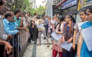Students outside a NEET exam centre in Santacruz, Mumbai on Sunday.(Satish Bate/HT Photo)