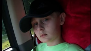 Trenton McKinley continues to suffer from nerve pain and daily seizures and will have to go through a final surgery to reconnect the missing pieces of his skull. He has already had three brain surgeries so far.(Facebook/ Jennifer Reindl)