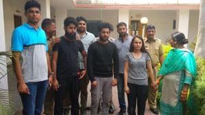 27-year-old Priya Seth (in grey T-shirt), Dikshant Kamra (in grey pyjamas) and Lakshya Walia at Jhotwara police station in Jaipur.(HT Photo)