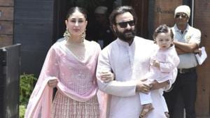 Kareena Kapoor Khan, Saif Ali Khan and Taimur pose for the camera at Sonam Kapoor's wedding.(Viral Bhayani)