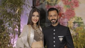 Sonam Kapoor and Anand Ahuja at their wedding reception in Mumbai on Tuesday.(Viral Bhayani)