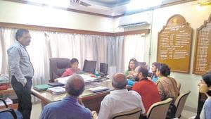 A Sreelakshmi, deputy conservator of forest(centre,seated), interacting with residents of Deccan on Wednesday.(HT PHOTO)
