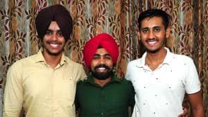 (From Left) Tenth rank holder Gurbeer Singh Sohal; Japneet Singh, 41st rank and Amandeep Kumar, 100th rank in Chandigarh on Thursday.(Ravi Kumar/HT)