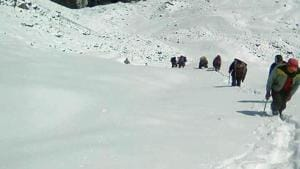 Villagers return from the base camp of Barmal peak in Chamoli district because of the heavy snowfall.(Sanjay Kunwar/HT Photo)