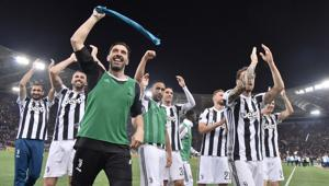 Juventus won a seventh straight Serie A title on Sunday after a goalless draw against ten-man Roma at the Stadio Olimpico. The Turin giants become the first team to complete the league and Cup double for four consecutive seasons. It is the 34th Scudetto in Juventus's history.(AFP)