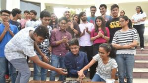 Toppers cutting cake after the announcement of ICSE and ISC results at the Sanskar valley school in Bhopal on Monday.(Mujeeb Faruqui/HT Photo)