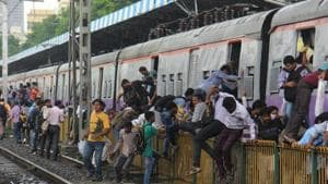 Railways had put up barricades at many places between the tracks to prevent track crossing. Nevertheless, the commuters continue to cross the tracks illegally, officials say.(HT FILE)