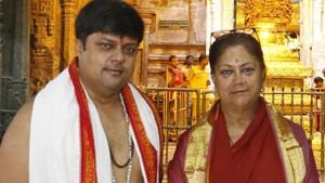 CM Vasundhara Raje with MP and son Dushyant Singh (left) at the Tirupati temple in Andhra Pradesh.(HT Photo)