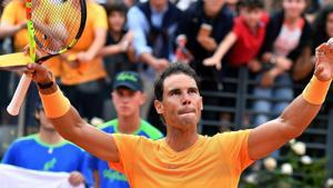 Rafael Nadal celebrates after winning his match against Bosnia's Damir Dzumhur at the Italian Open tennis tournament in Rome.(AP)