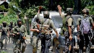 Army soldiers in action outside a house where militants were hiding during an encounter.(PTI File Photo)
