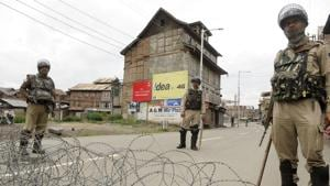 Paramilitary soldiers stand guard during restriction in downtown area of Srinagar.(HT File Photo)
