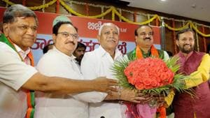 Union ministers and Bharatiya Janata Party leaders Prakash Javadekar (right), Ananth Kumar and JP Nadda greet Karnataka unit chief of the party BS Yeddyurappa, after he was elected leader of the BJP legislature party, in Bengaluru, on Wednesday.(PTI photo)