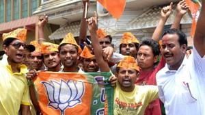 BJP workers in Jhargram celebrating victory on Thursday.(HT Photo)