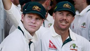 David Warner (R)and Steve Smith have been banned for one year each for being involved in ball-tampering during Australia's third Test against South Africa in March.(AFP)